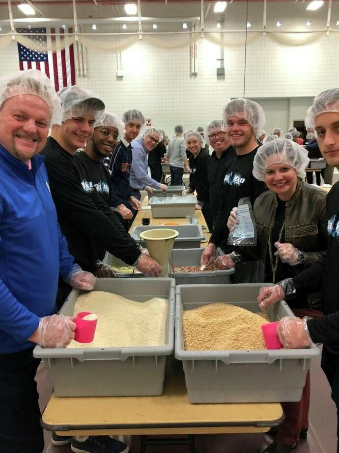 Volunteers withKids Coalition Against Hunger (KCAH),Circle K, Kiwanis Club and students from Northwood University,the United Way of Midland County and leaders at Dow Chemical Co. package meals for those in need during an event Tuesday at theNorthwood University Hach Student Life Center. (Courtesy: Dow Chemical Co.)