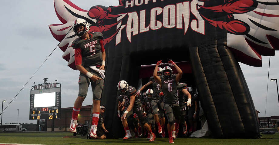 Huffman-Hargrave junior quarterback Justin Shively (5) leads his teammates onto the field before the start of the Falcon's matchup with Concordia Lutheran at Falcon Stadium in Huffman on Sept. 28, 2018. Photo: Jerry Baker/Contributor