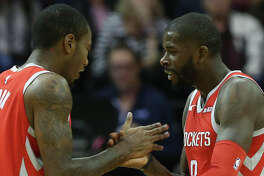 Houston Rockets forward Gary Clark (6) celebrates James Ennis III's (8) successful the fourth quarter of the NBA game against the Golden State Warriors at Toyota Center on Thursday, Nov. 15, 2018, in Houston. The Houston Rockets defeated the Golden State Warriors 107-86.