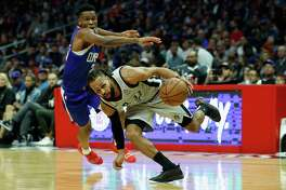 LOS ANGELES, CA - NOVEMBER 15: Patty Mills #8 of the San Antonio Spurs dribbles past Shai Gilgeous-Alexander #2 of the Los Angeles Clippers during the second half of a game at Staples Center on November 15, 2018 in Los Angeles, California. NOTE TO USER: User expressly acknowledges and agrees that, by downloading and or using this photograph, User is consenting to the terms and conditions of the Getty Images License Agreement (Photo by Sean M. Haffey/Getty Images)