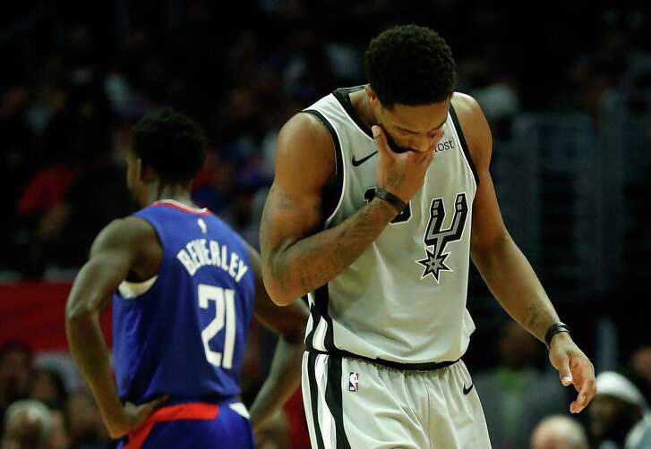 LOS ANGELES, CA - NOVEMBER 15: DeMar DeRozan #10 of the San Antonio Spurs holds his face against the San Antonio Spurs Patrick Beverley #21 of the Los Angeles Clippers looks on during the second half of a game at Staples Center on November 15, 2018 in Los Angeles, California. NOTE TO USER: User expressly acknowledges and agrees that, by downloading and or using this photograph, User is consenting to the terms and conditions of the Getty Images License Agreement (Photo by Sean M. Haffey/Getty Images)