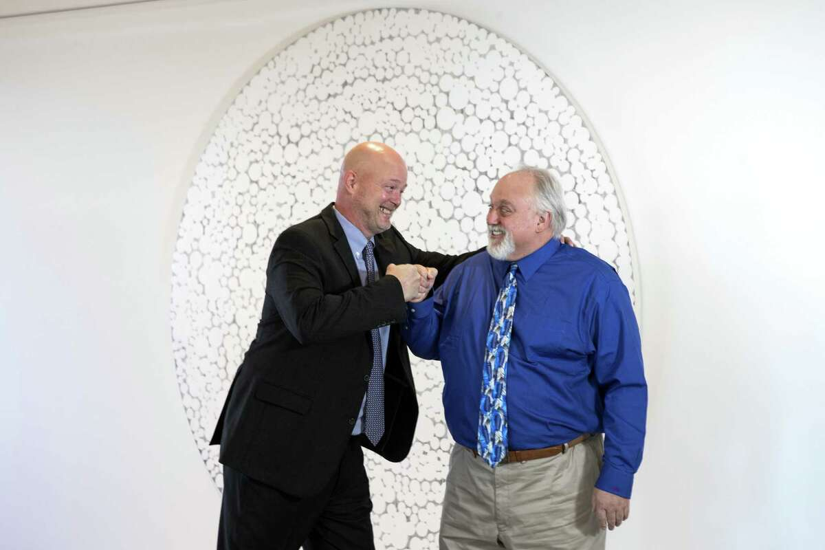 Maynard Holt, chief executive officer, left, and John Gibson, chairman of energy technology, joke around as they pose for a portrait at Tudor, Pickering & Holt on Monday, Oct. 29, 2018, in Houston.