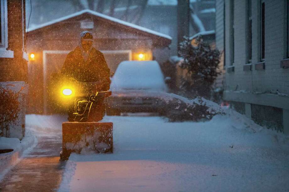 Bruce Cramer removes snow from a driveway on Fifth Avenue during the storm that covered the Capital Region with snow Friday  Nov. 16, 2018 Saratoga Springs, N.Y. (Skip Dickstein/Times Union) Photo: SKIP DICKSTEIN, Albany Times Union