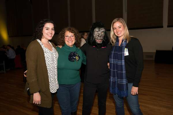 The Guerrilla Girls, feminist activist artists, spoke to a sold out crowd at the McNay Art Museum Thursday night.