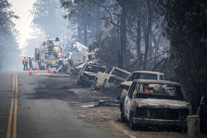 Destroyed cars along a road in Paradise, Calif., following the Camp Fire, on Nov. 13, 2018.