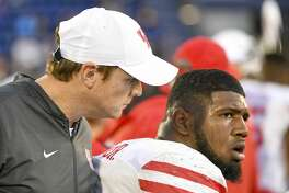 ANNAPOLIS, MD - OCTOBER 20: Houston Cougars defensive tackle Ed Oliver (10) talks with Houston Cougars head coach Major Applewhite in the second half on October 20, 2018, at Navy - Marine Corps Memorial Stadium in Annapolis, MD. The Houston Cougars defeated the Navy Midshipmen, 49-36. (Photo by Mark Goldman/Icon Sportswire via Getty Images)