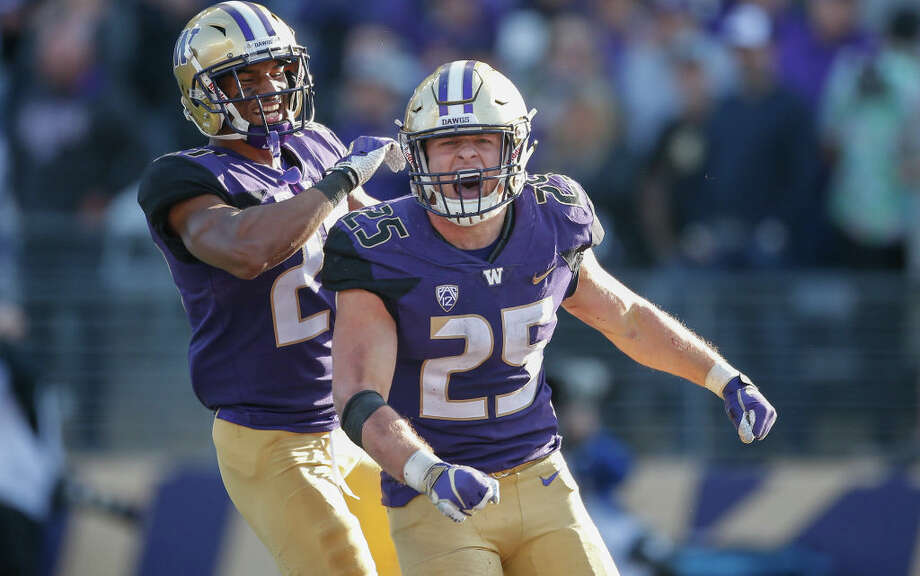 SEATTLE, WA - OCTOBER 20:  Linebacker Ben Burr-Kirven #25 (R) of the Washington Huskies is congratulated by defensive back Keith Taylor #27 after making an interception in the fourth quarter against the Colorado Buffaloes at Husky Stadium on October 20, 2018 in Seattle, Washington.  (Photo by Otto Greule Jr/Getty Images) Photo: Otto Greule Jr/Getty Images / 2018 Getty Images