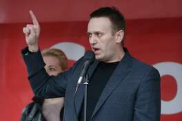 Alexey Navalny, a leader of the opposition to Russian President Vladimir Putin, at a rally with his wife Yulia Navalny (left), in Moscow on May 6, 2013.