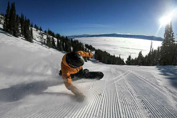 A snowboarder enjoys the solitude on a steep descent at Jackson Hole Mountain Resort in Wyoming.
