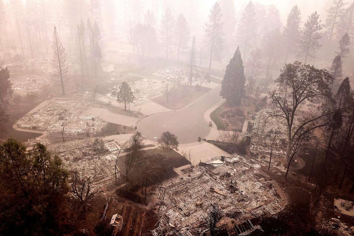 The flattened homes at Mountain Meadow Court at Country Oak Drive, Thursday, Nov. 15, 2018, in Paradise, Calif. As of this morning, the Camp Fire has burned 140,000 acres. The wildfire is 40% contained. 56 people have died.