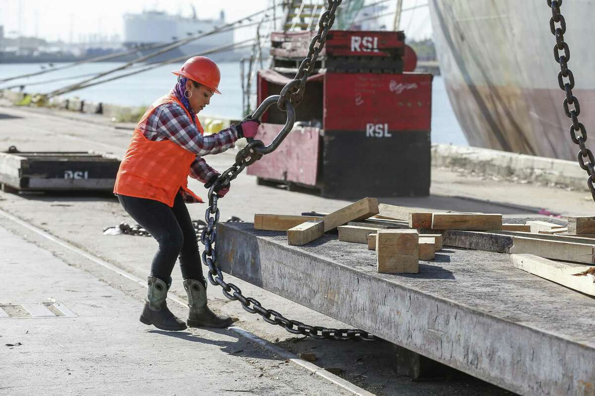 Longshoremen Liliana Garcia unloads Mexican steel from a ship at the Port of Houston Thursday, Oct. 11, 2018, in Houston.
