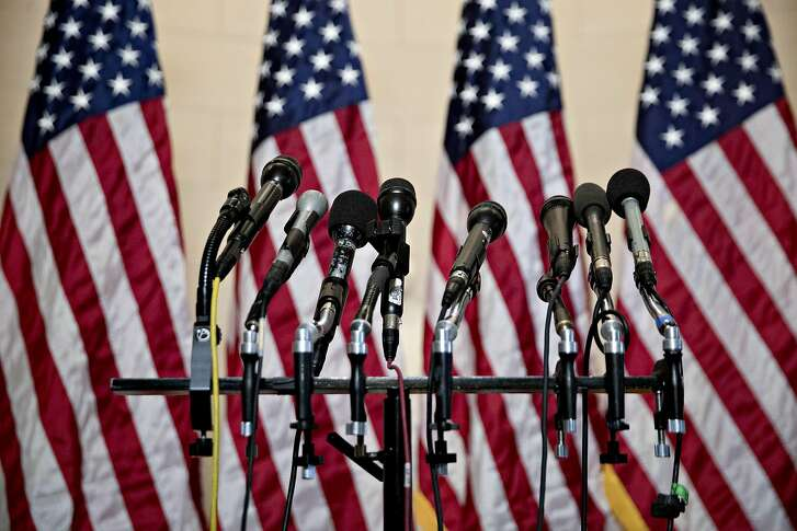 Microphones stand in front of American flags before a news conference after a GOP leadership election on Capitol Hill in Washington, D.C., U.S., on Wednesday, Nov. 14, 2018. House Republicans elected Representative Kevin McCarthy of California as their leader next year, with Steve Scalise of Louisiana and Liz Cheney of Wyomingfilling two other top party leadership posts as the GOP retreats to minority status in the chamber. Photographer: Andrew Harrer/Bloomberg