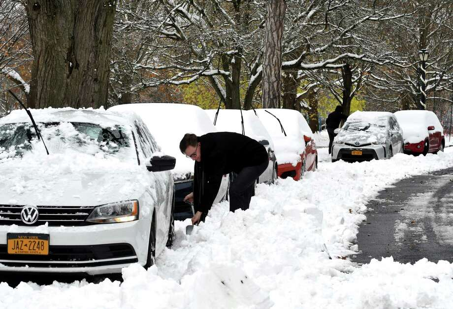 FILE — Kieran Murphy digs his car out the snow on Washington Park Rd. on Friday, Nov. 16, 2018, in Washington Park in Albany N.Y. (Will Waldron/Times Union) Photo: Will Waldron, Albany Times Union / 20045504A