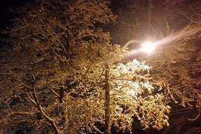 Nighttime scenes in Midland following the first snowfall of the season.