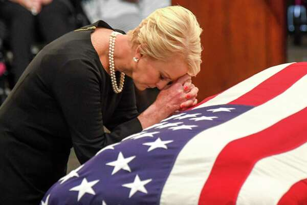 Cindy McCain, wife of late-Sen. John S. McCain says a prayer at his casket as he lies in state in the Capitol Rotunda.