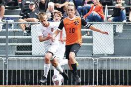Edwardsville's Ethan Miracle works past a Normal Community defender during a home game in the regular season. Miracle is the Intelligencer's MVP for boys' soccer.