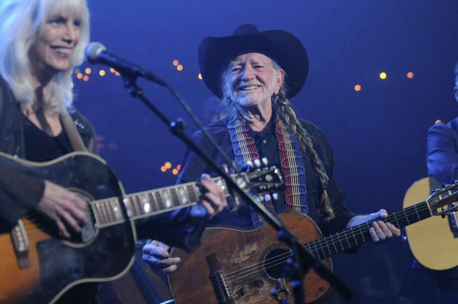 Emmylou Harris, left, performs with Willie Nelson during Austin City Limits Hall of Fame. Photo: Scott Newton, HOEP / Associated Press / Courtesy of KLRU