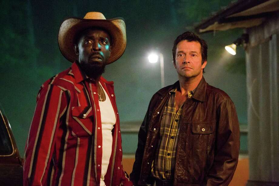 "Michael Kenneth Williams as Leonard Pine, left, and James Purefoy as Hap Collins in ""Hap and Leonard."" Photo: Hilary Gayle, HONS / AP / SundanceTV"