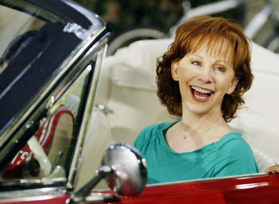 "Country superstar Reba McEntire smiles on the set of her television comedy ""Reba."" Photo: DAMIAN DOVARGANES, STF / AP / AP"