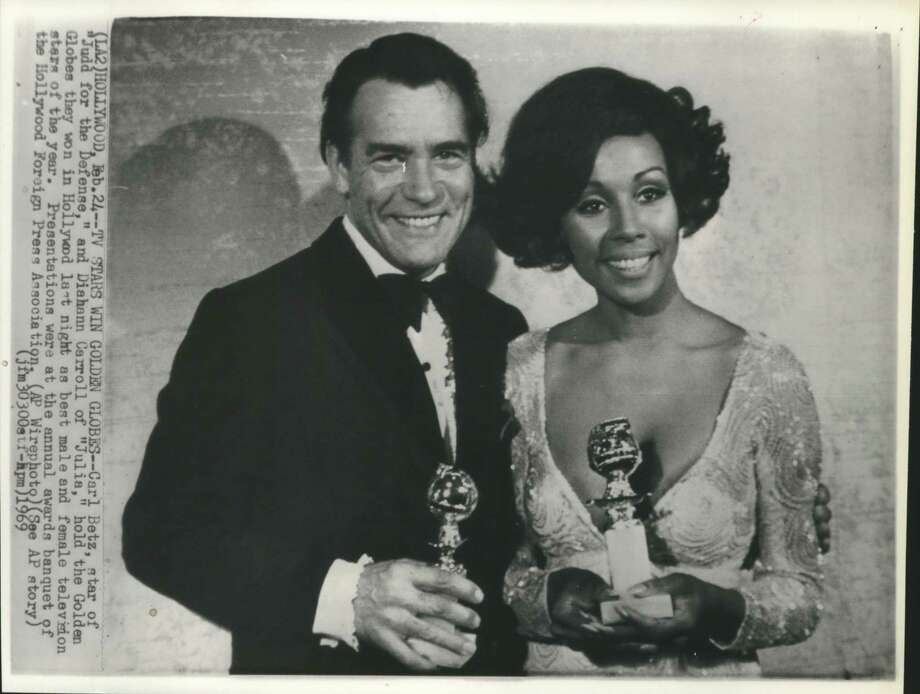 "Golden Globes Awards: Carl Betz, star of ""Judd for the Defense,"" and Diahann Carroll of ""Julie,"" hold the Golden Globes they won in Hollywood last night as best male and female television stars of the year. Presentations were at the annual awards banquet of the Hollywood Foreign Press Association . Photo: AP (Associated Press) / Houston Chronicle"