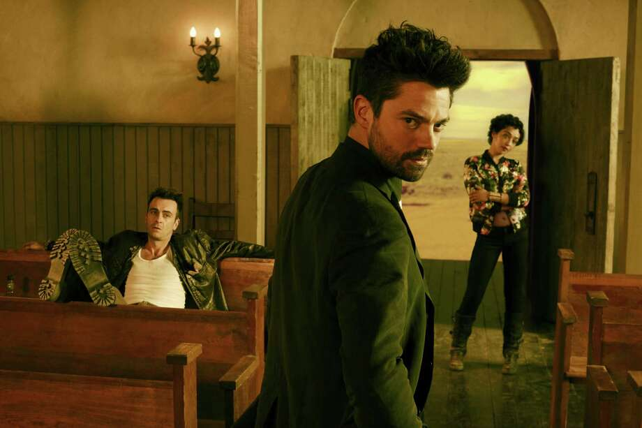 "Dominic Cooper, center, plays complicated West Texas preacher Jesse Custer. He's surrounded by his two charmingly wicked cohorts Tulip (Ruth Negga) and Cassidy (Joseph Gilgun) in ""Preacher"" on AMC. Photo: Matthias Clamer/AMC / Matthias Clamer/AMC / © AMC Networks Entertainment LLC. and Sony Pictures Television Inc. All RIghts Reserved."