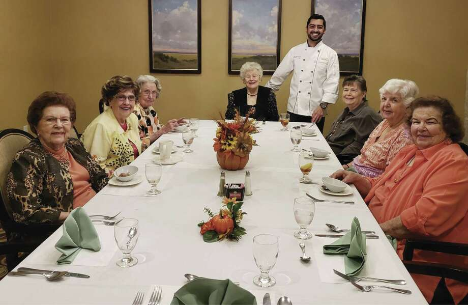 Chef Imrai Sanvicente, standing, has created a special Thanksgiving menu for community residents.