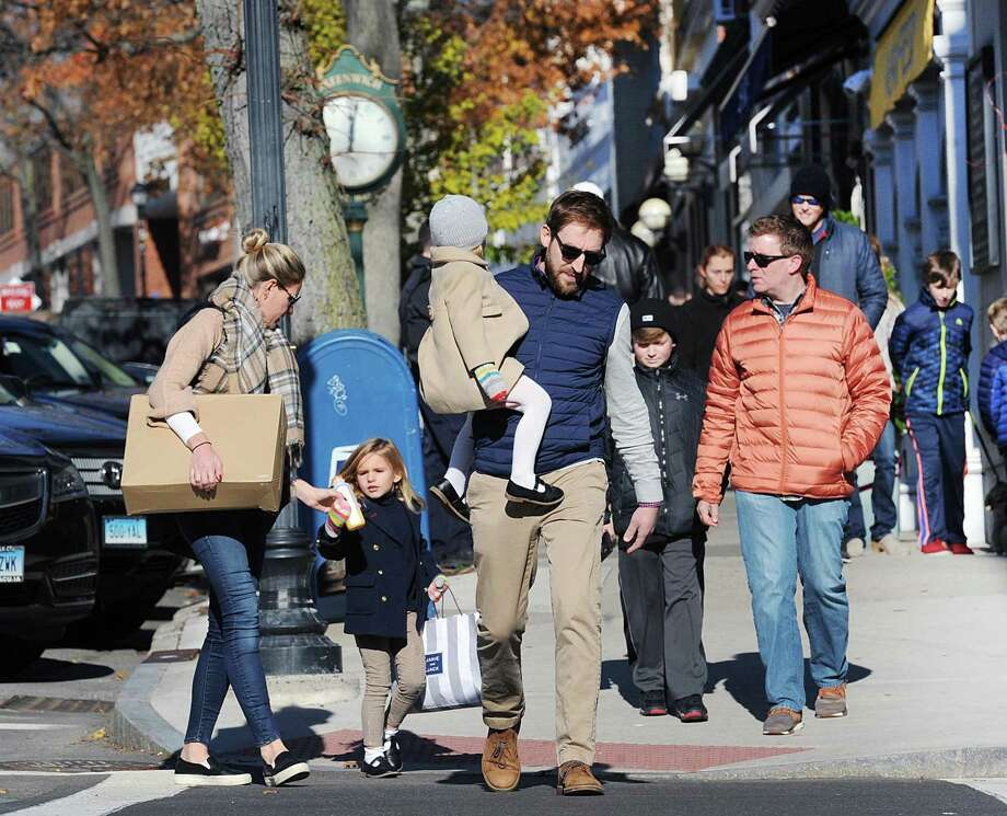Black Friday shoppers in November 2017 on Greenwich Avenue in Greenwich, Conn. Southwestern Connecticut led the nation in 2017 average personal income, at more than $110,000, though with the 3.2 percent rate of growth trailing the New York City region and the nation as a whole. Photo: Bob Luckey Jr. / Hearst Connecticut Media / Greenwich Time
