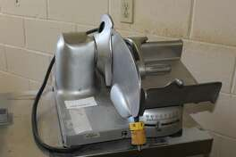 A meat slicer for auction at the Paul Brown Alternative Education Center in Beaumont.