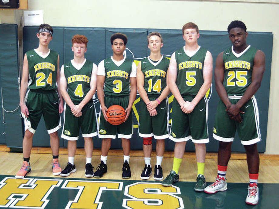 Seniors on the Metro-East Lutheran boys' basketball team are, from left to right, Cooper Krone, Zach Miller, Jason Williams, Jonah Wilson, Nolan Gutjahr and DaMonte Bean. Photo: Scott Marion/Intelligencer