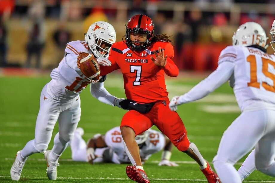 PHOTOS: College football rivalry trophies LUBBOCK, TX - NOVEMBER 10: Jett Duffey #7 of the Texas Tech Red Raiders tries to get past Davante Davis #18 of the Texas Longhorns during the 2nd half of the game on November 10, 2018 at Jones AT&T Stadium in Lubbock, Texas. Texas defeated Texas Tech 41-34. >>>Browse through the photos for a closer look at college football rivalry trophies ... Photo: John Weast, Getty Images / 2018 Getty Images