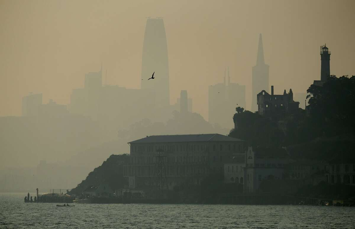 The San Francisco skyline is obscured by smoke and haze from wildfires behind Alcatraz Island Wednesday, Nov. 14, 2018, in San Francisco. (AP Photo/Eric Risberg)