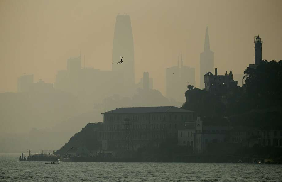 The San Francisco skyline rising behind Alcatraz is obscured by smoke and haze from wildfires burning out of control in Butte County in November. Photo: Eric Risberg / Associated Press 2018