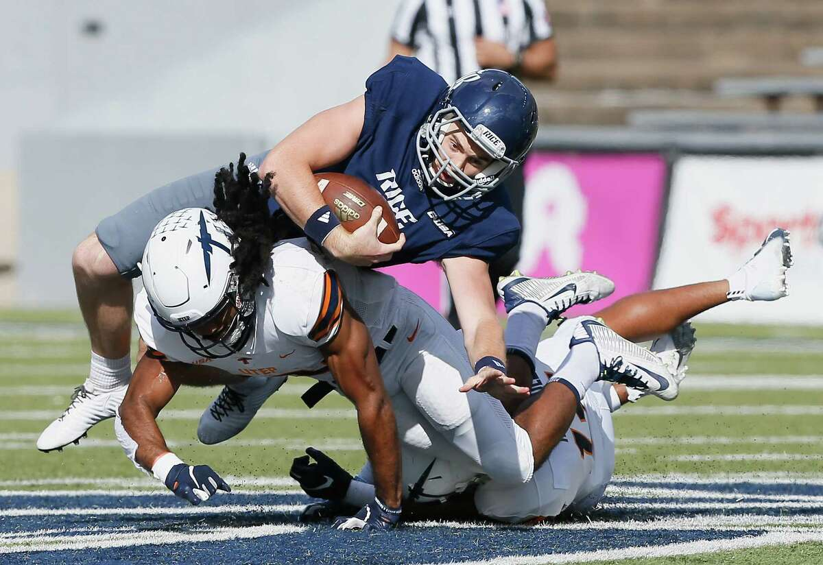 PHOTOS:College football players who shaped Texas schools HOUSTON, TX - NOVEMBER 03: Austin Walter #2 of the Rice Owls is tackled by Jerrell Brown #18 of the UTEP Miners and Tyson Wilson #14 in the second quarter on November 3, 2018 in Houston, Texas. >>>Browse through the photos for a look at the best college football players at each school in Texas ...
