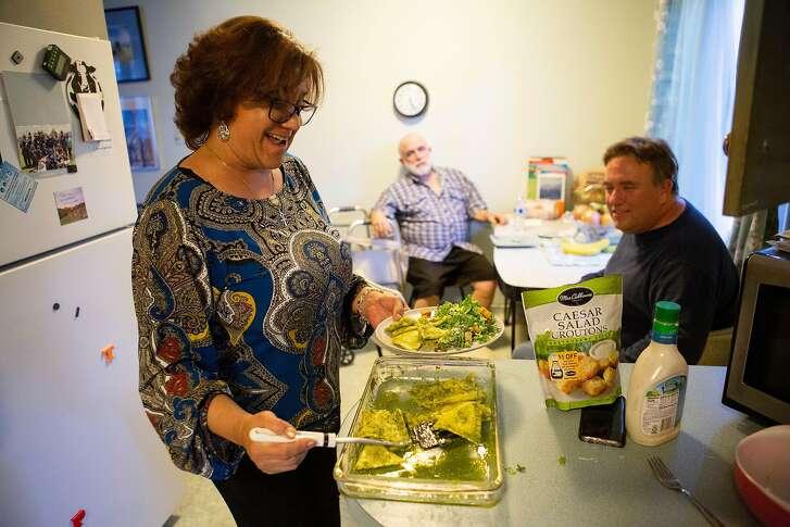 From left: Gina Cooper makes ravioli for Jim Mathews and Joe Mathews on Friday, Oct. 19, 2018, in San Mateo, Calif.