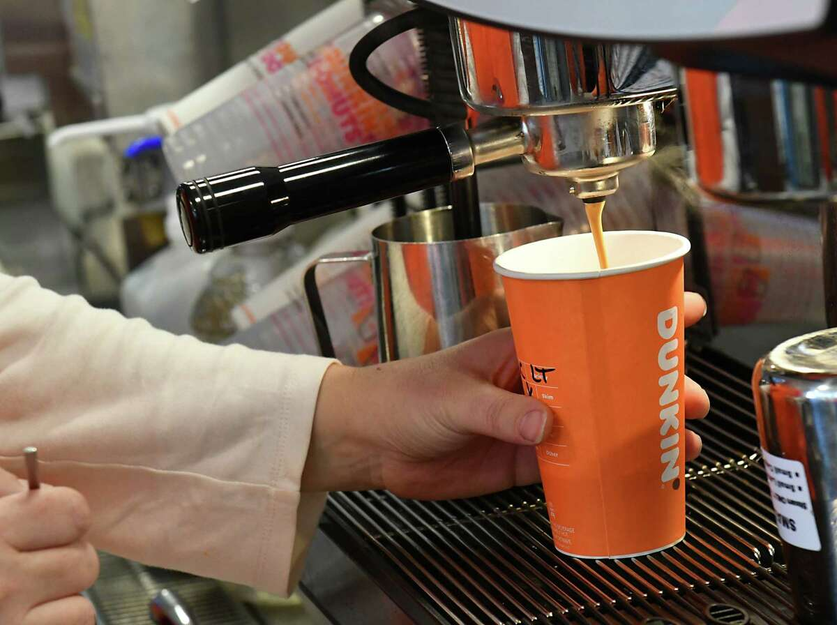 Dunkin' Donuts employee Darlene Scott makes a white chocolate latte on Friday, Nov. 16, 2018 in Colonie, N.Y. Dunkin' Donuts was introducing their new espressos and cold brews that Dunkin' is introducing as it battles McCafe and Starbucks for market share. (Lori Van Buren/Times Union)