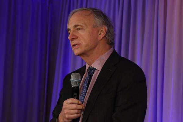 "Ray Dalio, founder and chief investment officer of Bridgewater Associates, discusses his ""principles"" during a speech at the Greenwich Economic Forum on Friday, Nov. 16, 2018, at the Delamar Greenwich Harbor Hotel in Greenwich, Conn."