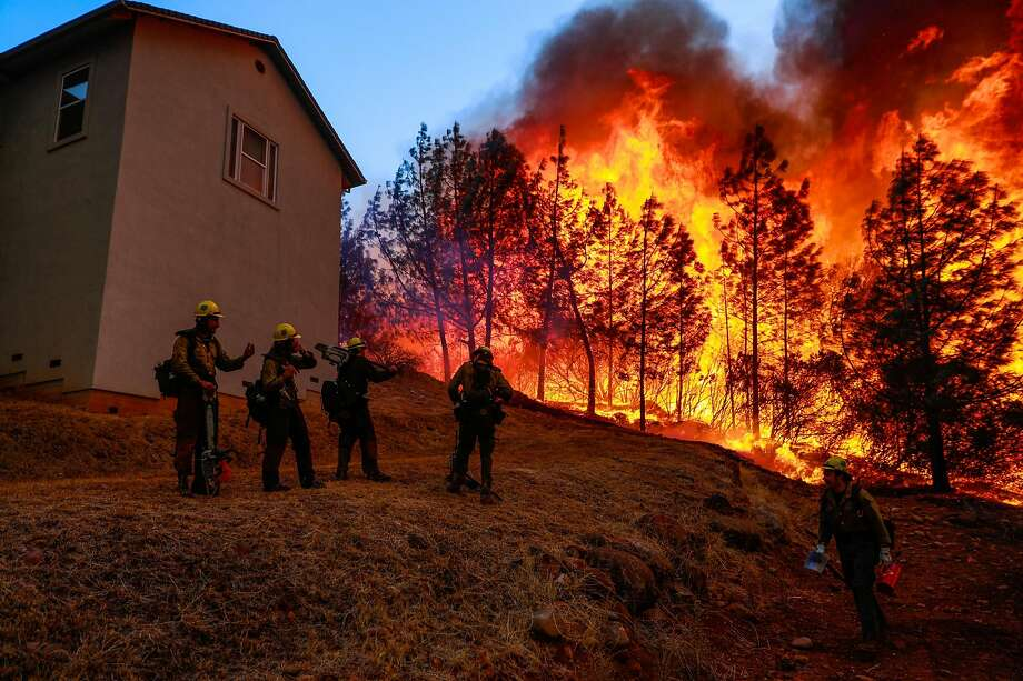 A Hotshot firefighter crew watches as the Camp Fire burns off of Pentz Road in Paradise. Photo: Gabrielle Lurie / The Chronicle