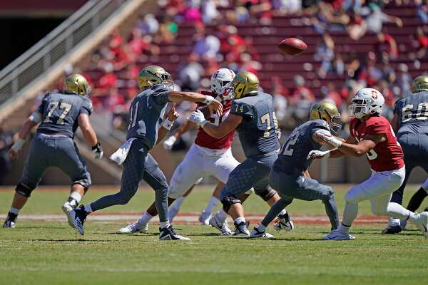 UC Davis Aggies quarterback Hunter Rodrigues (11) throws an interception during the second half of an NCAA football game between the Stanford Cardinal and UC Davis Aggies at Stanford Stadium, Saturday, Sept. 15, 2018, in Stanford, Calif.