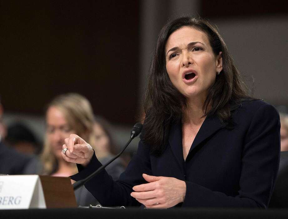 """(FILES) In this file photo taken on September 5, 2018, Facebook COO Sheryl Sandberg testifies before the Senate Intelligence Committee on Capitol Hill in Washington, DC. - Sandberg on on November 16, 2018, pledged a """"thorough"""" review of a political consulting firm's work for the social network giant after one target criticized the techniques used as """"black ops."""" Like founder Mark Zuckerberg, Sandberg has said she was unaware her firm was working with Definers Public Affairs, a Republican opposition research group. (Photo by Jim WATSON / AFP)JIM WATSON/AFP/Getty Images Photo: JIM WATSON, AFP/Getty Images"""