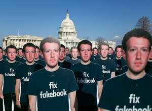 FILE -- Cardboard cutouts of Mark Zuckerberg, Facebook's chief executive, set out in front of the U.S. Capitol in Washington, April 10, 2018. Facebook has gone on the attack as one scandal after another � Russian meddling, data sharing, hate speech � has led to a congressional and consumer backlash. (Lawrence Jackson/The New York Times)