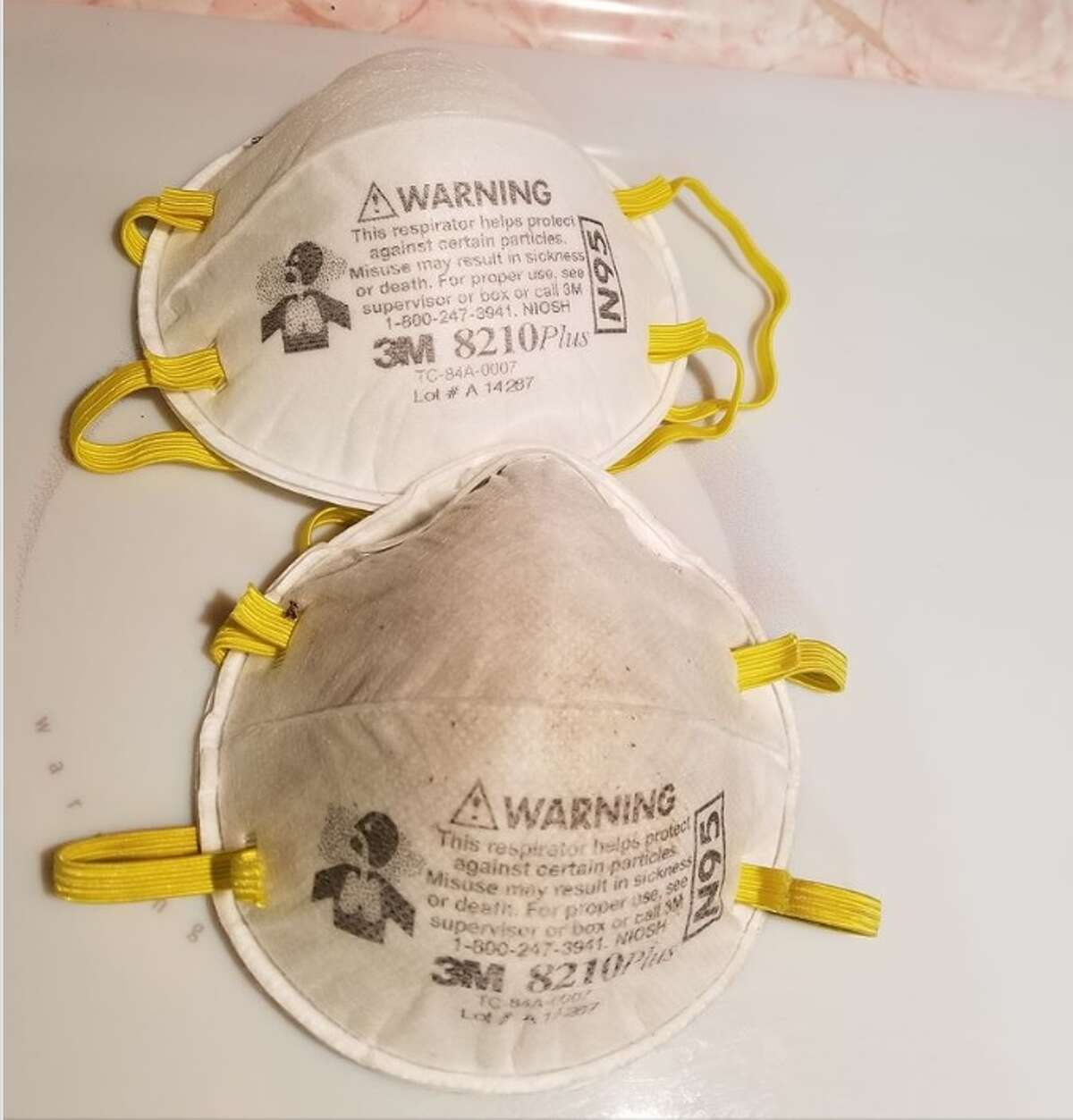 A new dust mask (top) compared to a dust mask used outside for several hours (bottom) during the hazardous air quality conditions November 15th, 2018.