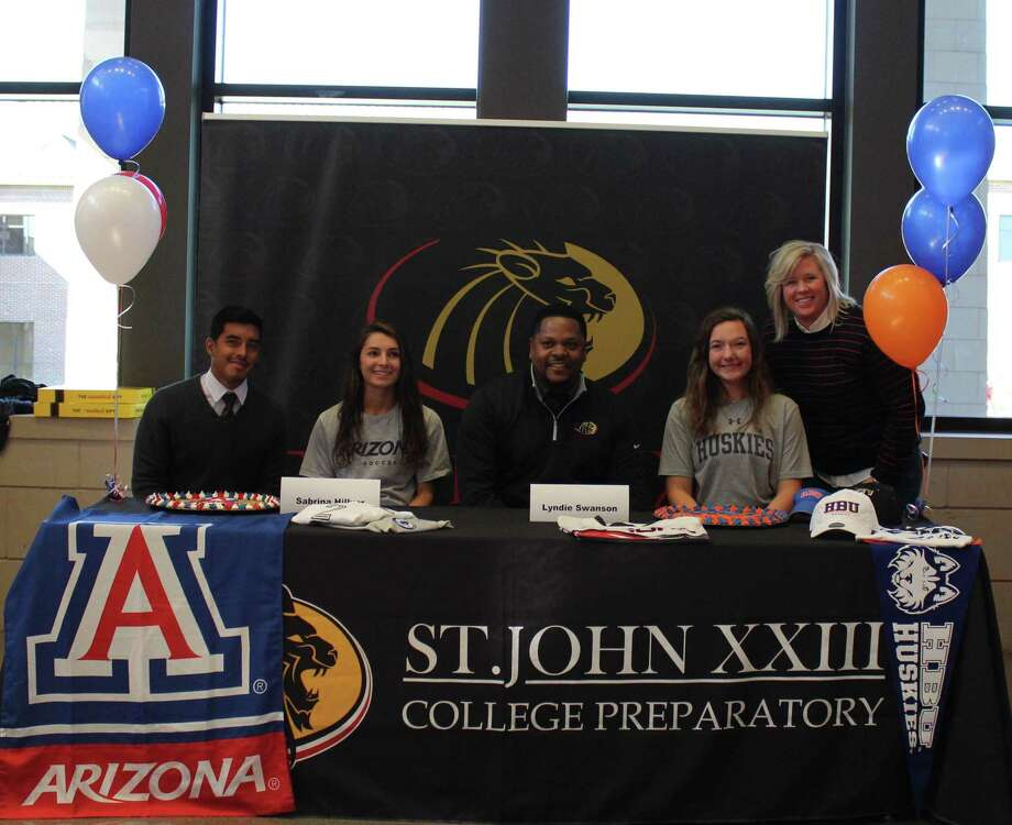 St. John XXIII College Preparatory's Sabrina Hillyer and Lyndie Swanson signed letters of intent to continuing the sports careers in college. Hillyer signed with the University of Arizona to continue playing soccer. Swanson signed with Houston Baptist University to continue her softball career. Photo: Courtesy Photo