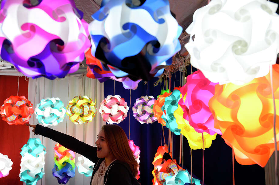 Charyti Touchet looks at colorful lamps for sale at a booth in the vendor hall at the YMBL South Texas State Fair on Friday night.  Photo taken Friday 3/23/18 Ryan Pelham/The Enterprise Photo: Ryan Pelham/Ryan Pelham/The Enterprise / ?2017 The Beaumont Enterprise/Ryan Pelham
