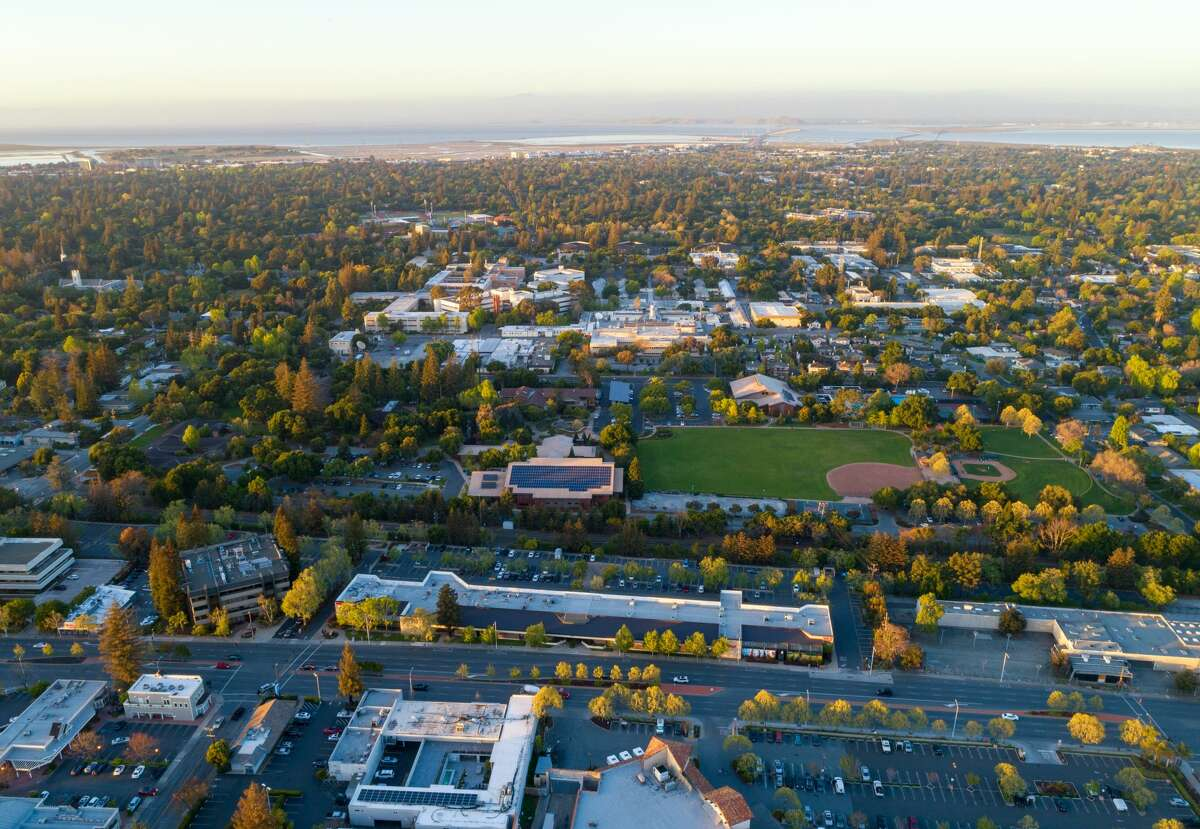 Aerial: flying over Menlo Park in Silicon Valley at sunset. 19th April 2018