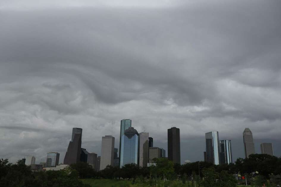 Storm clouds form around the downtown skyline in Houston. ( Steve Gonzales / Houston Chronicle )