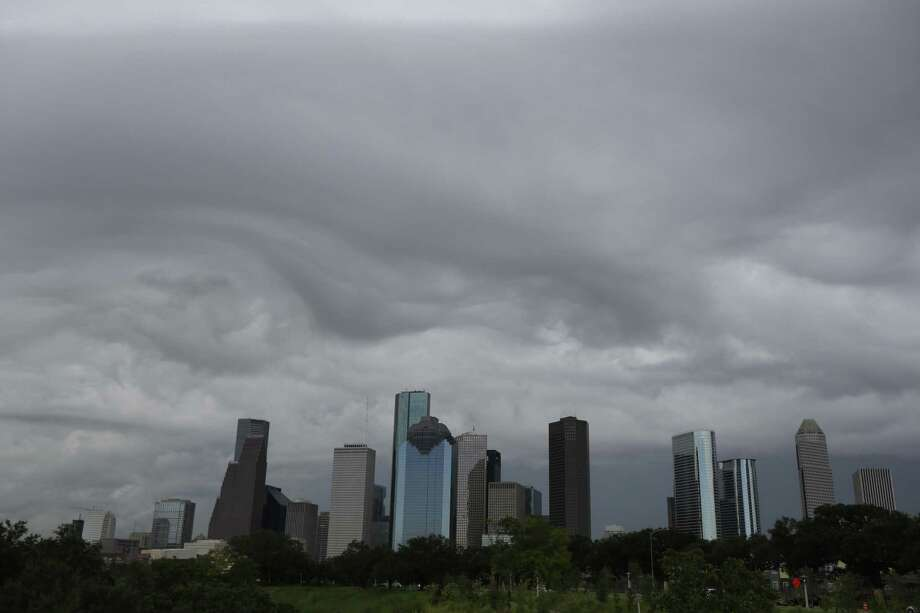 Storm clouds form around the downtown skyline in Houston. ( Steve Gonzales / Houston Chronicle ) Photo: Steve Gonzales, Staff / Houston Chronicle / Ã     2015 Houston Chronicle