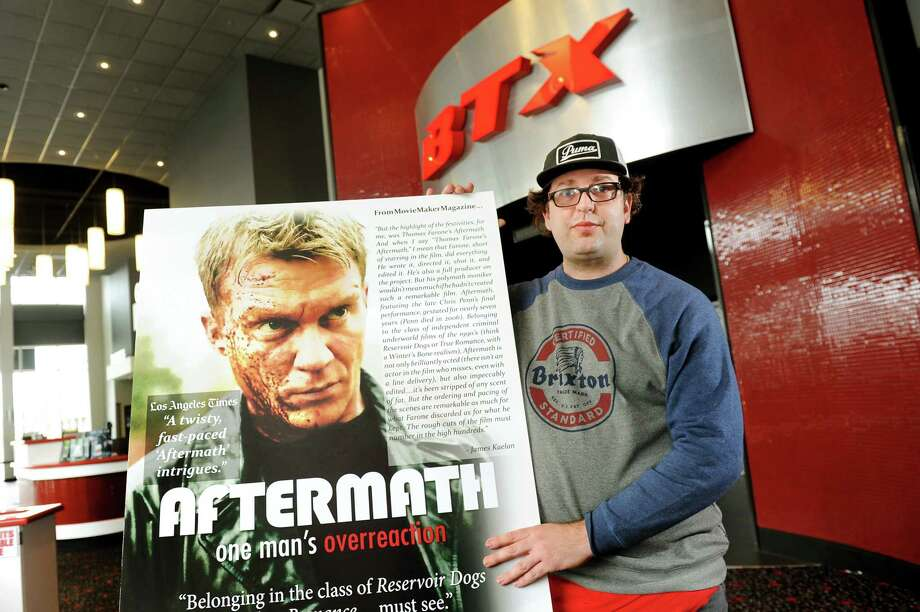 "Thomas Farone with a poster of his movie ""Aftermath"" on Wednesday, March 4, 2015, at Bow Tie Criterion Cinema in Saratoga Springs, N.Y. (Cindy Schultz / Times Union) Photo: Cindy Schultz / 10030856A"