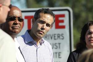 """Texas General Land Commissioner George P. Bush listens to Harris County Flood Control District Executive Director Russell """"Russ"""" Poppe, Harris County Commissioners R. Jack Cagle and Rodney Ellis talk about the Harris County Buyout Plans Post Harvey Recovery of Glen Forest Detention Basin on Greens Bayou Friday, Nov. 16, 2018, in Houston."""