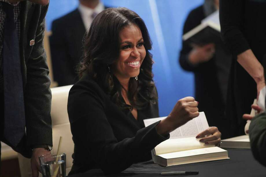 "Former first lady Michelle Obama kicks off her ""Becoming"" book tour with a signing at the Seminary Co-op bookstore on November 13, 2018 in Chicago, Illinois. Photo: T, Staff / Getty Images / 2018 Getty Images"