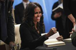 "Former first lady Michelle Obama kicks off her ""Becoming"" book tour with a signing at the Seminary Co-op bookstore on November 13, 2018 in Chicago, Illinois."